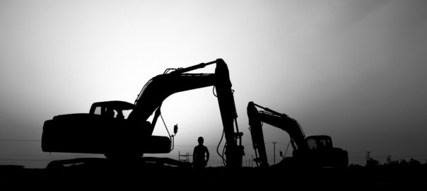 Silhouette of mining cranes